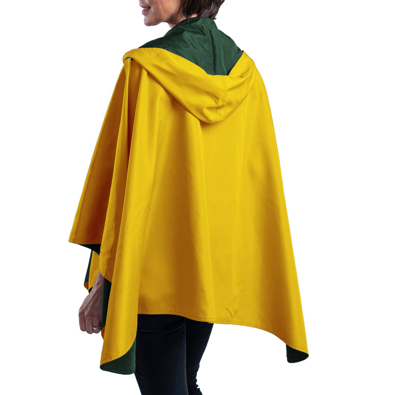 Women wearing a Green & Gold Wind RainCaper travel cape with the Green side out, revealing the Gold Wind color at the lapels and neck
