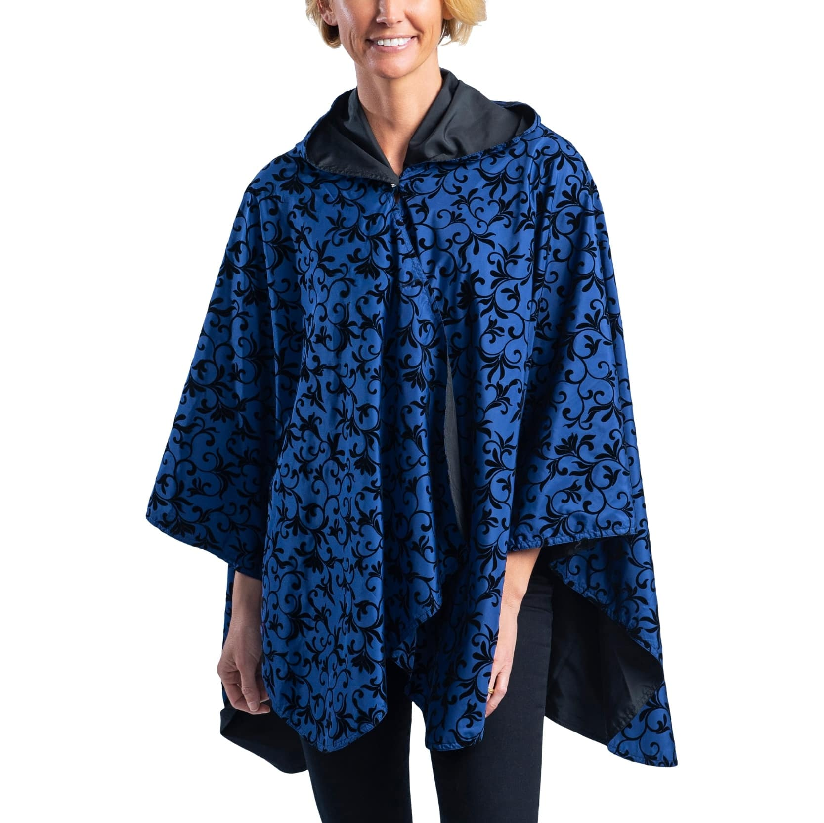 Woman wearing a Midnight Blue with Velvet Swirls RainCaper travel cape