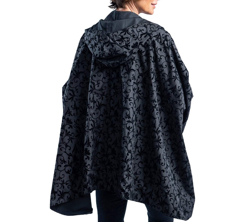 Women wearing a Black with Velvet Swirls RainCaper travel cape