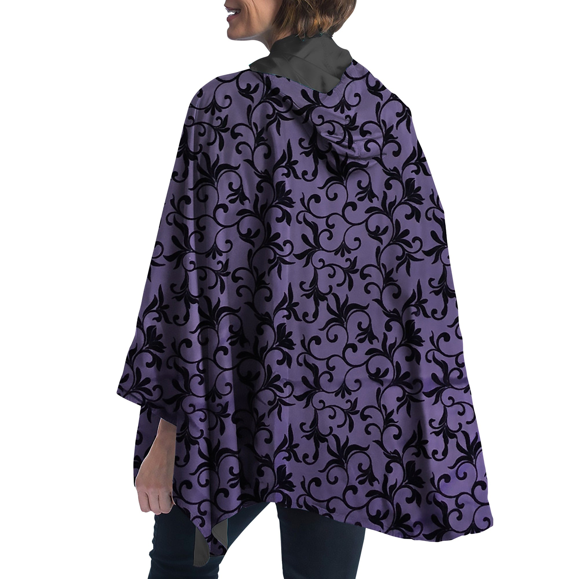 Women wearing a Plum with Velvet Swirls RainCaper travel cape