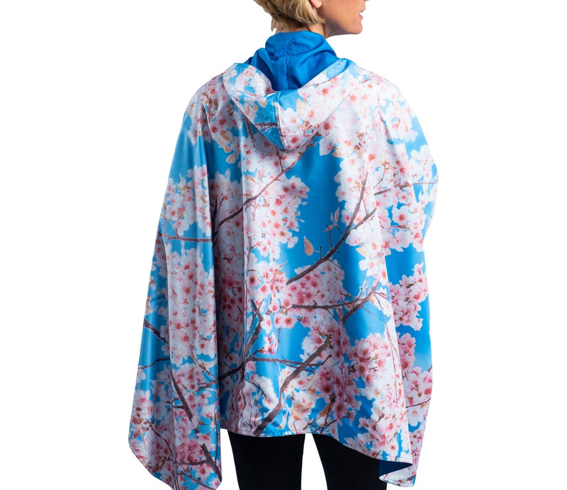 RainCaper Blue Sky with Cherry Blossoms Travel Cape & Womens Rain Coat