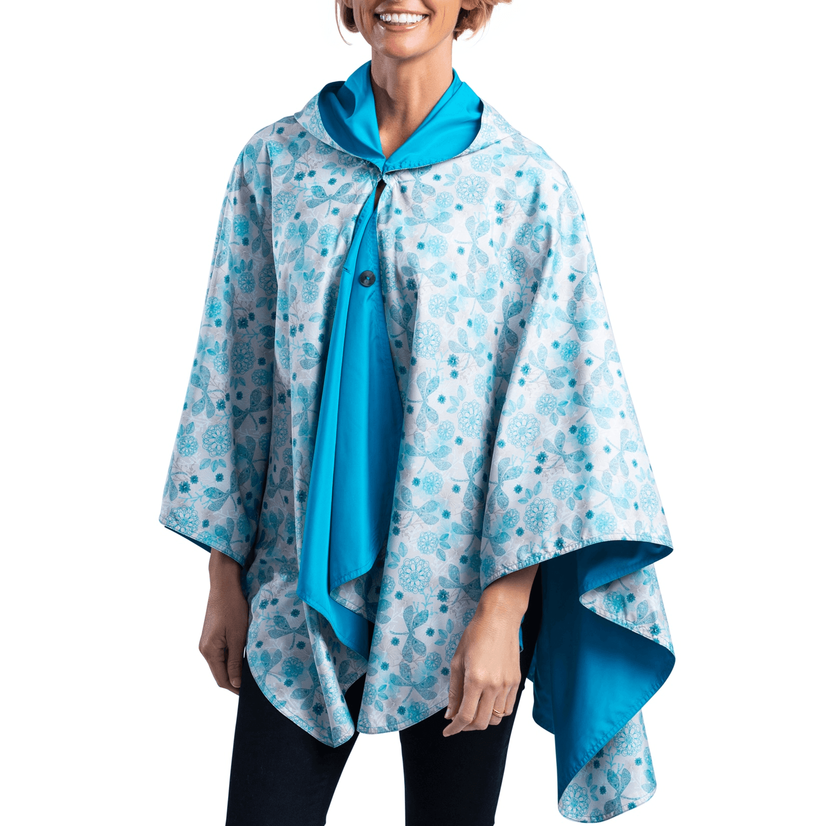 Woman wearing an Aqua and Dragonflies Wind RainCaper Travel Cape with the Dragonflies Wind side out, revealing the Aqua print at the lapels and neckline