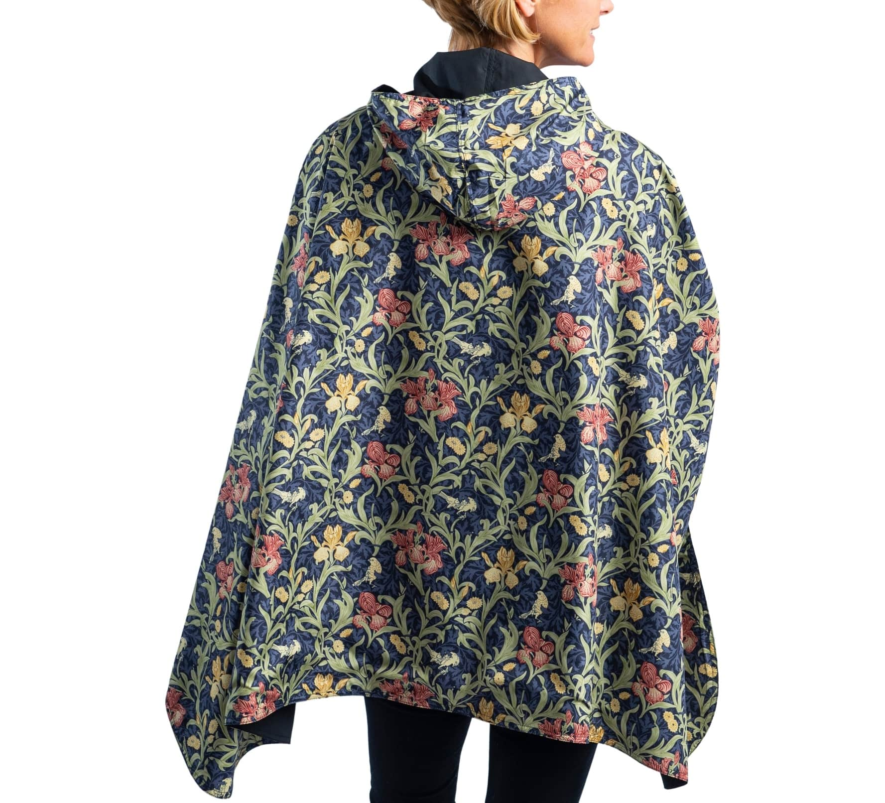 Woman wearing a Black/William Morris Golden Flowers travel cape with the Black side out, revealing the William Morris Golden Folowers print at the lapels,necklines and cuffs