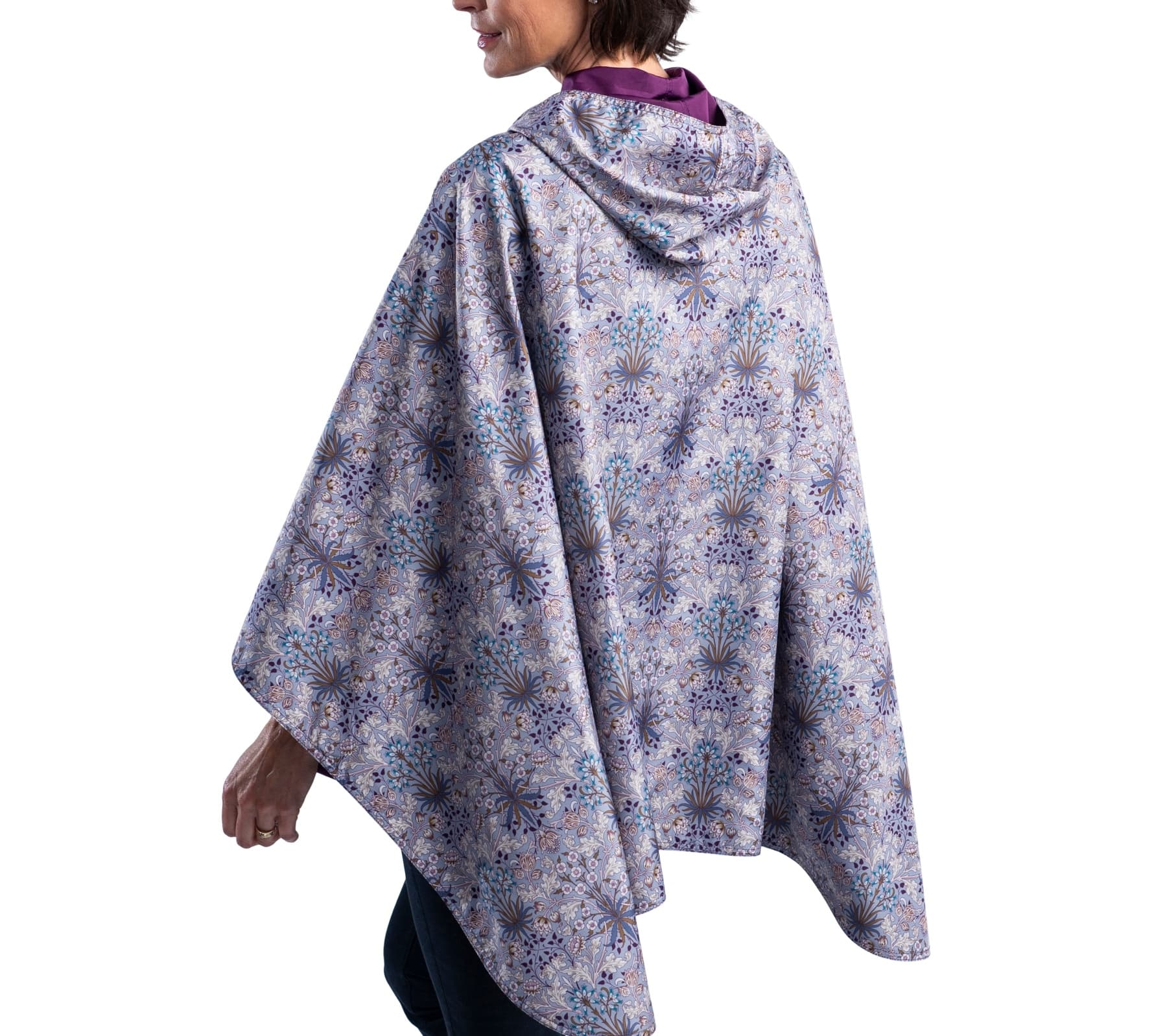 Women wearing a Plum/William Morris Hyacinth RainCaper travel cape