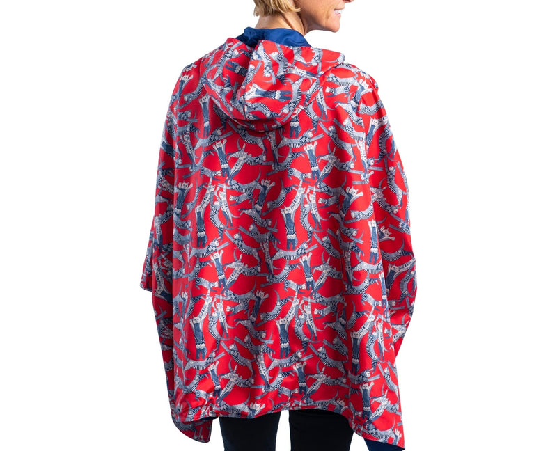 Women wearing a Navy/Cool Cats RainCaper travel cape with the Navy side out, revealing the Cool Cats print at the lapels and cuffs