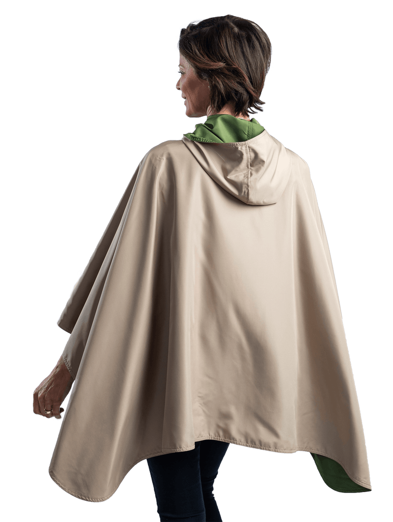 Women wearing an Olive/Camel RainCaper travel cape with the Olive side out, revealing the Camel color at the lapels and neck