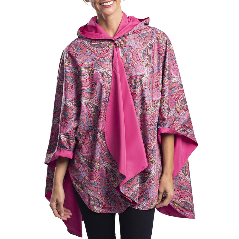 Woman wearing a Rose/Paisley RainCaper travel cape with the Rose side out, revealing the Paisley print at the lapels,necklines and cuffs