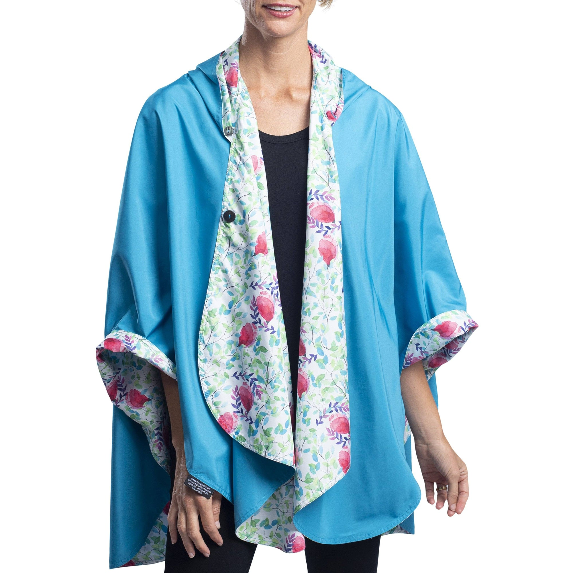 Women wearing an Aqua & Spring Watercolor RainCaper travel cape with the Aqua side out, revealing the Spring Watercolor print at the lapels and cuffs