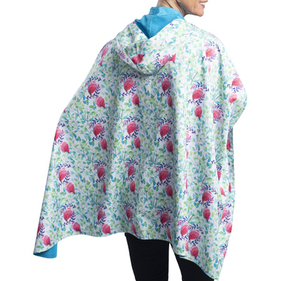 Women wearing an Aqua & Spring Watercolor RainCaper travel cape