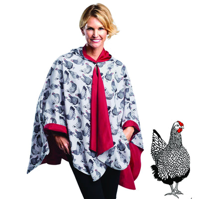 Woman wearing a Crimson/Hens & Chickens cape which reverses to Crimson. She is standing with a blow-up of the Hen print detail.