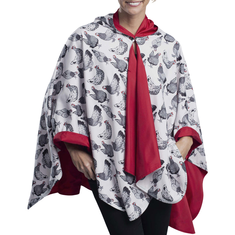 Women wearing a Crimson/Hens & Chickens Reversible RainCaper travel cape with the Crimson side out, revealing the Hens & Chickens print at the lapels and cuffs