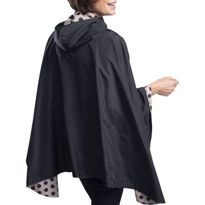 Women wearing a Black/Camel Dots Reversible RainCaper travel cape
