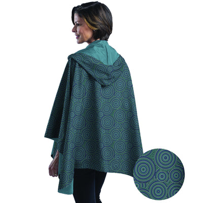 Woman wearing a Soft Teal & Circle Dots cape which reverses Soft Teal. She is standing with a blow-up of the Circle Dots print detail.