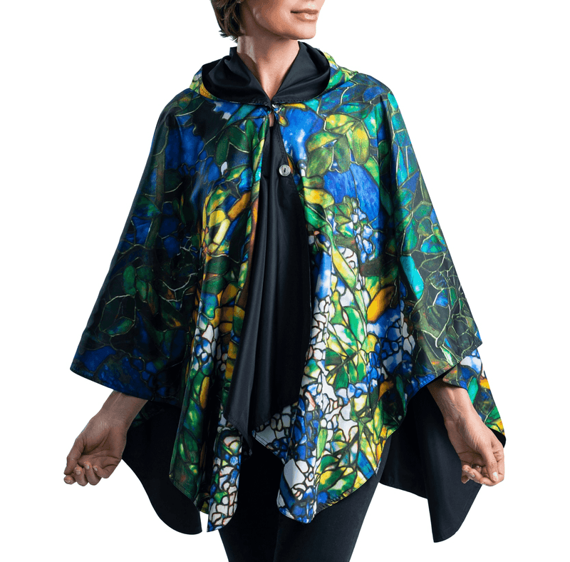 Woman wearing a Tiffany Wisteria Travel Cape.
