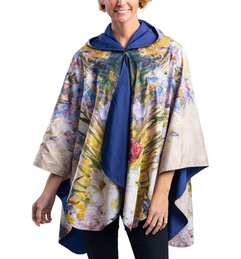 Woman wearing a RainCaper Tiffany Peonies & Iris Travel Cape.