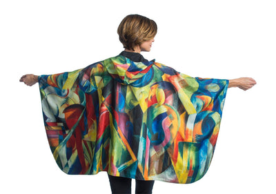 "Woman wearing a Warm Royal/Franz Marc ""Stables"" lined rain and travel cape by RainCaper."