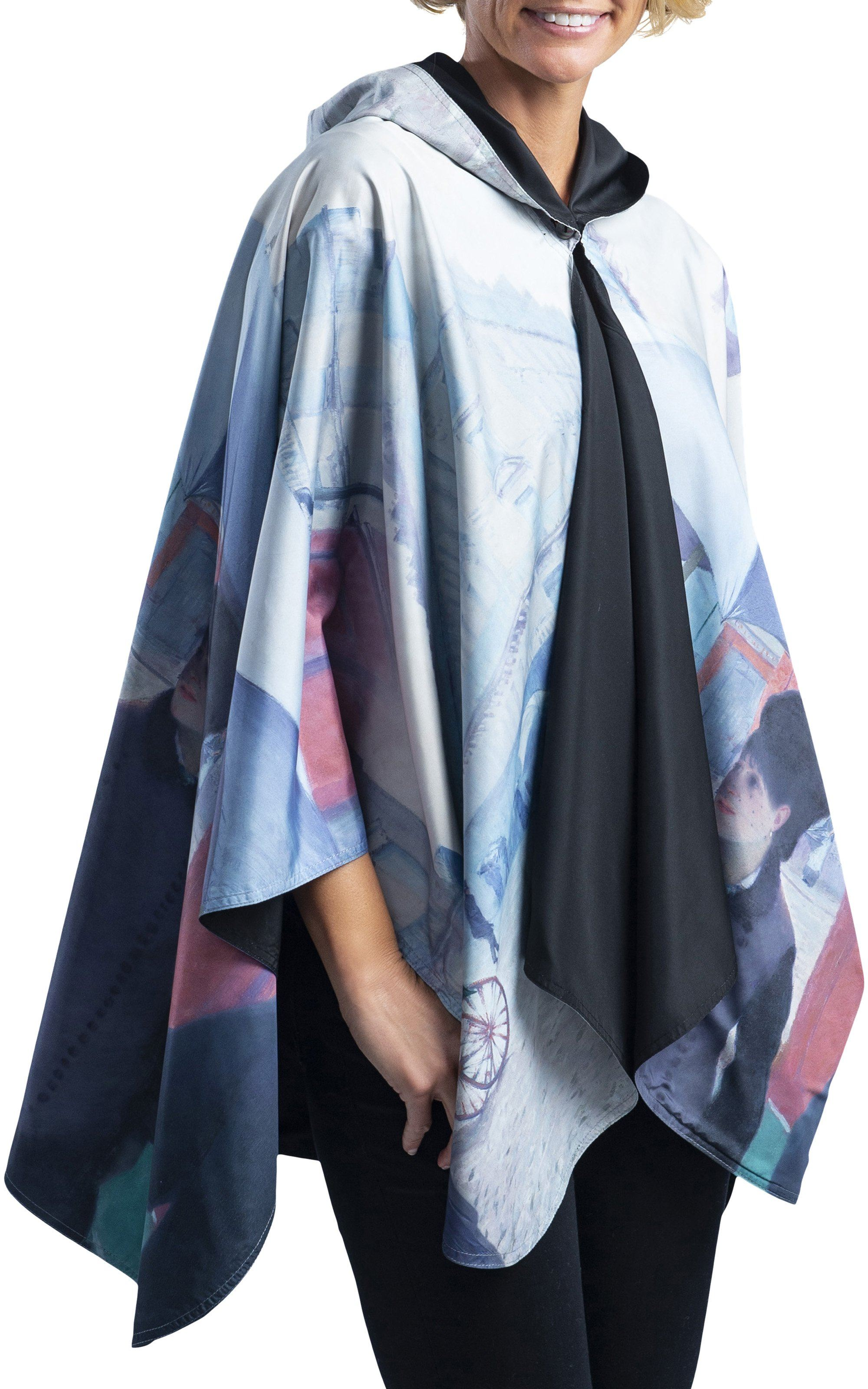 Multi-color reversible cape that protects from rain and wind; the womens raincoat alternative is worn by a woman. The rain cape has images of vintage people wearing top hats and Victorian garb while walking in the rain.