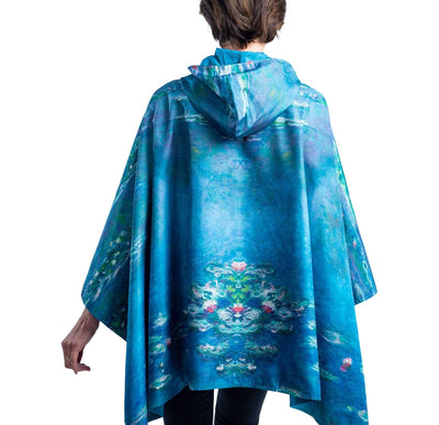 Woman wearing a RainCaper Monet Water Lilies travel cape.