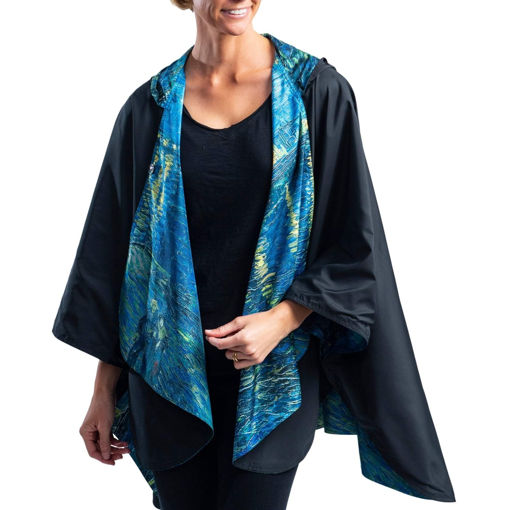 Woman wearing a RainCaper van Gogh Over the Rhone Travel Cape.