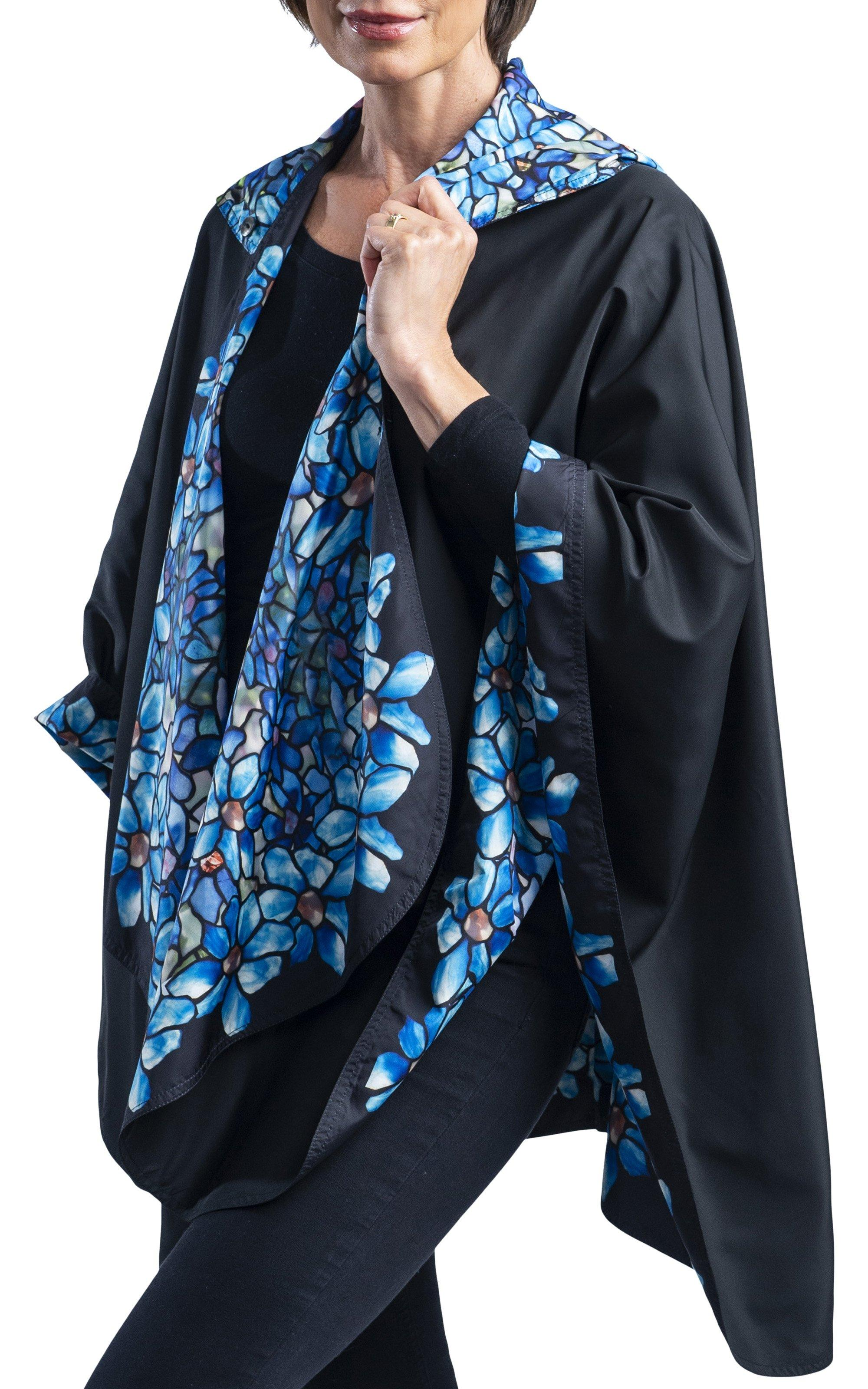 Woman wearing a RainCaper Tiffany Clematis Travel Cape.