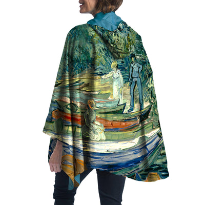 Woman wearing a RainCaper van Gogh Bank of the Oise at Auvers Travel Cape.