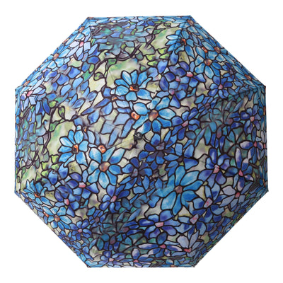 A top view of the artwork as adapted on a RainCaper Tiffany Clematis inside-out umbrella