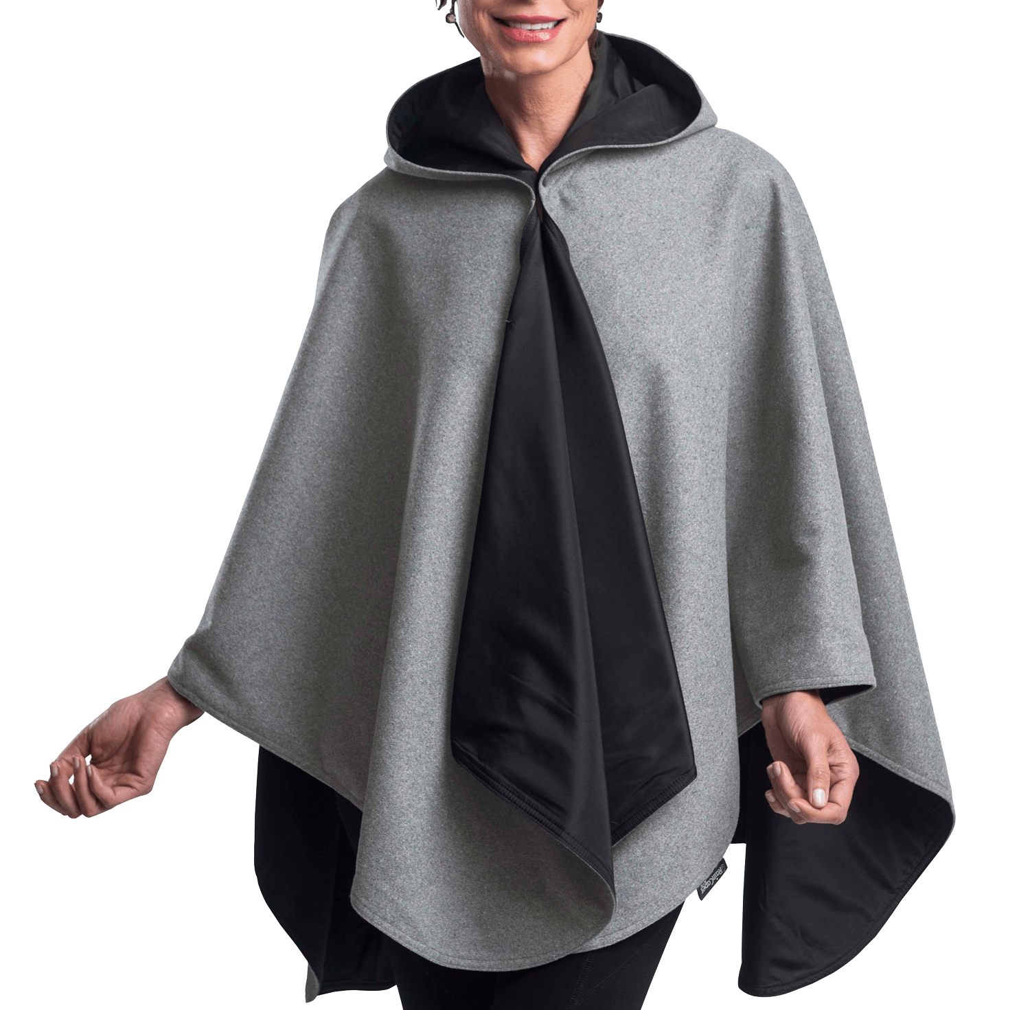 Woman wearing a WarmCaper Warm Pewter Grey/Black Rainproof rain and travel cape by RainCaper