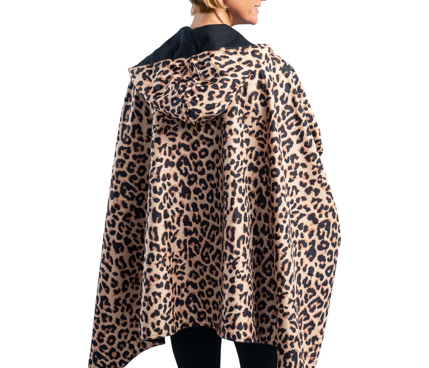 Woman wearing a WarmCaper Warm Black & Rainproof Leopard lined rain and travel cape by RainCaper.