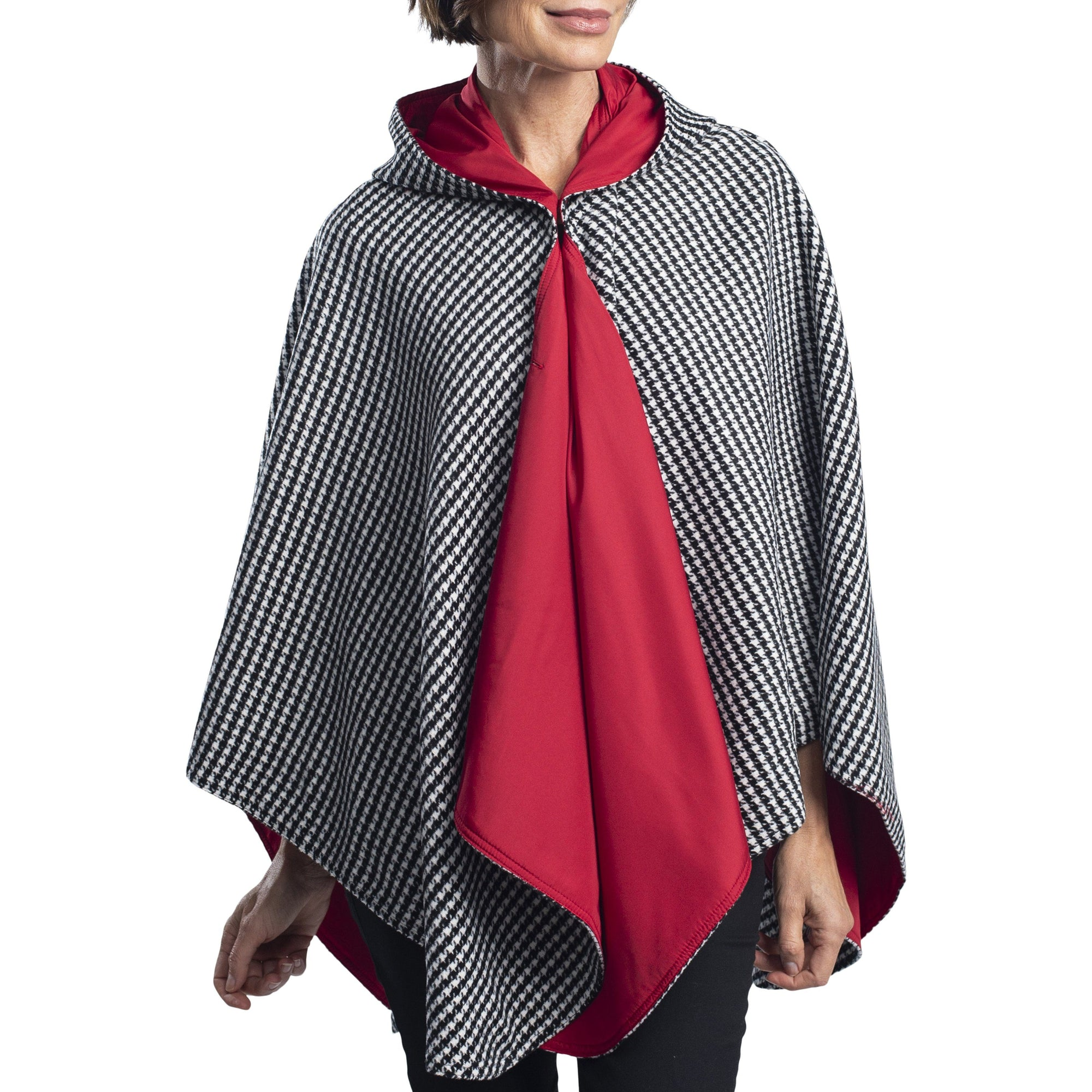 Woman wearing a WarmCaper Warm Houndstooth/Crimson Rainproof and travel cape by RainCaper