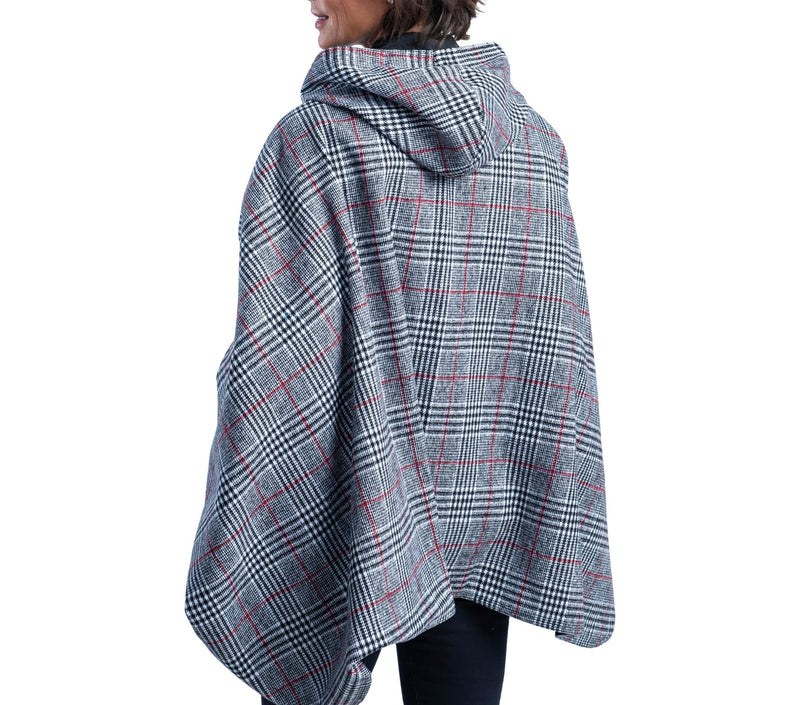 Woman wearing a WarmCaper Warm Glen Plaid/Rainproof Black print rain and travel cape. The reversible cape is warm Glen Plaid;the Rainproof Black print is visible on the hood and lapels