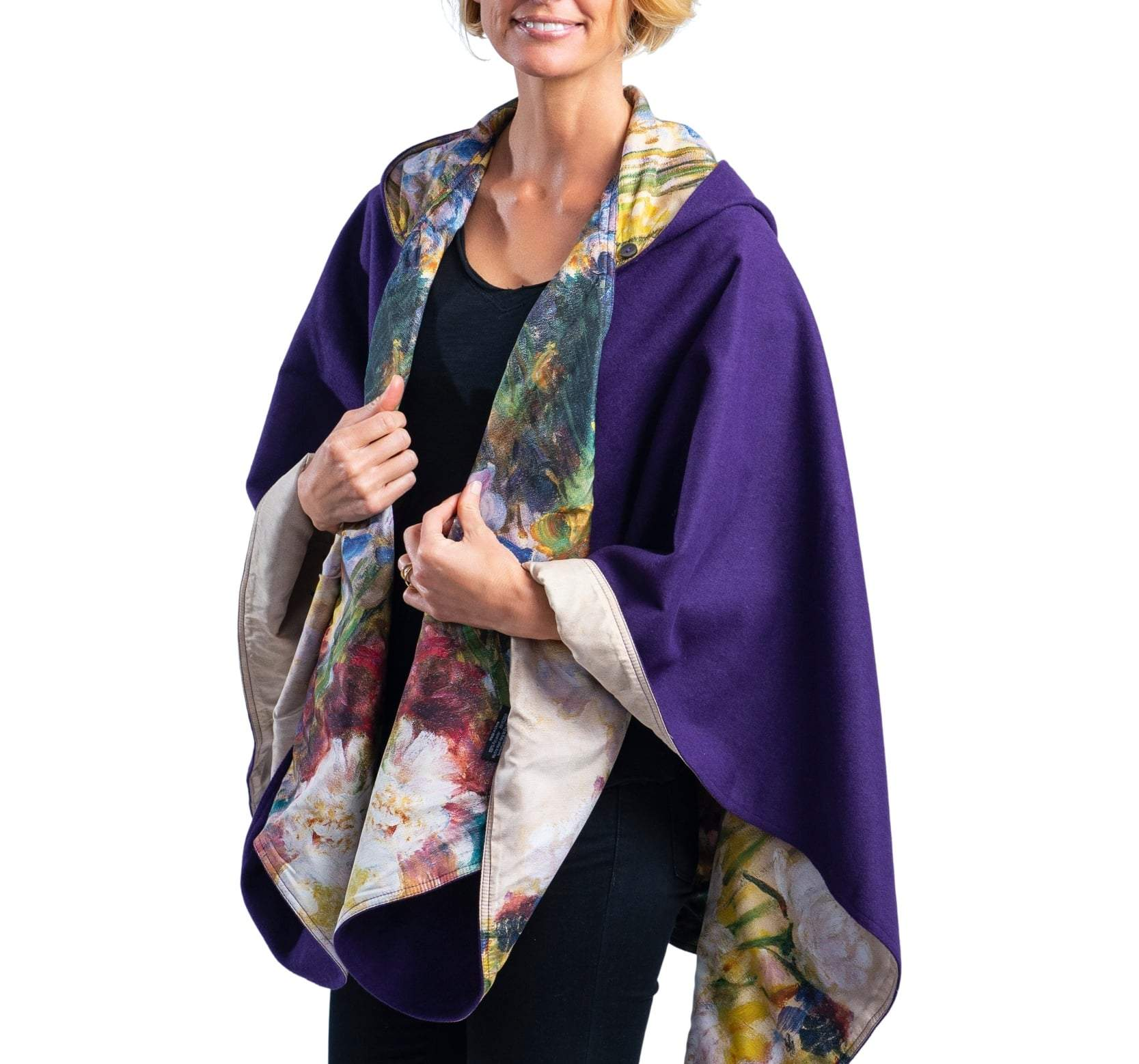 Woman wearing a WarmCaper Tiffany Peonies & Iris lined rain and travel cape by RainCaper.