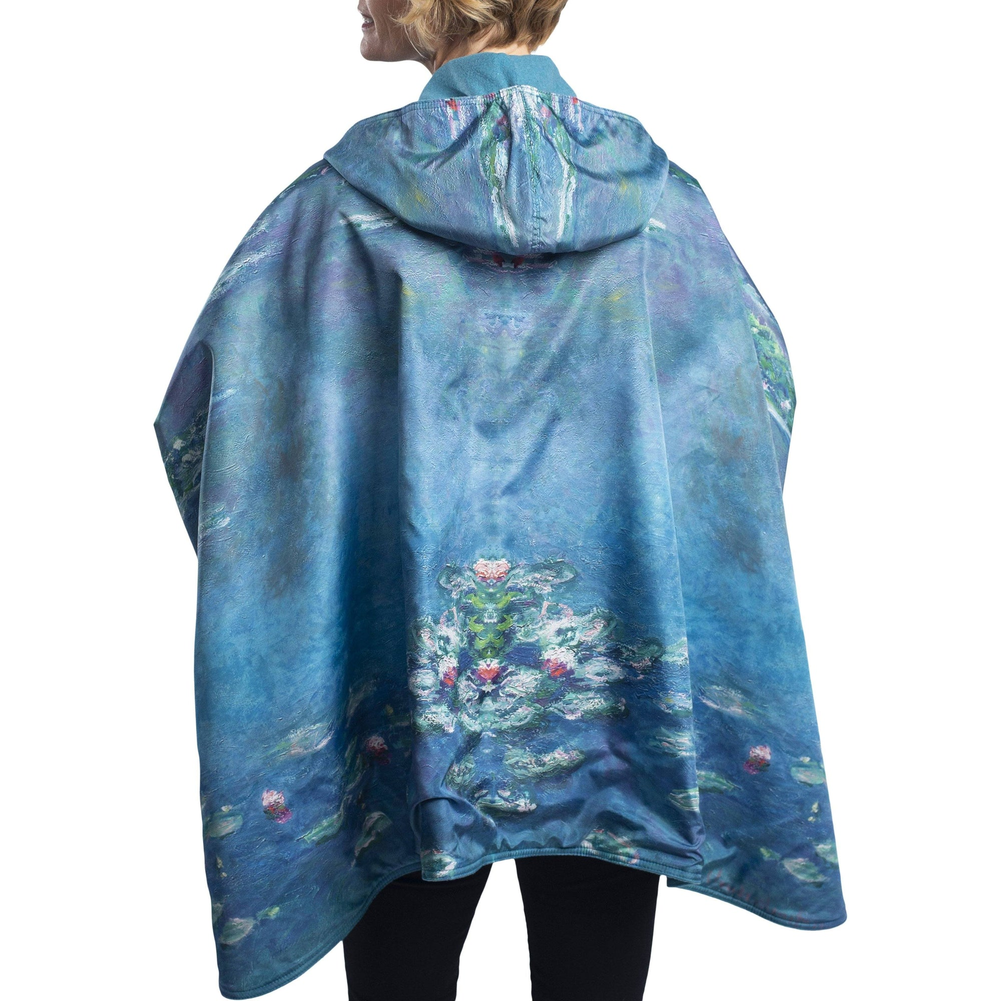 Woman wearing a WarmCaper Monet Water Lilies lined rain and travel cape by RainCaper.