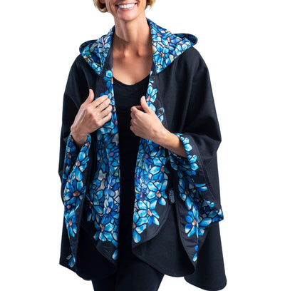 Woman wearing a WarmCaper Tiffany Clematis lined rain and travel cape by RainCaper.