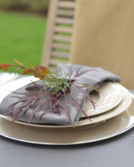 gray tablecloth with autumn leaves