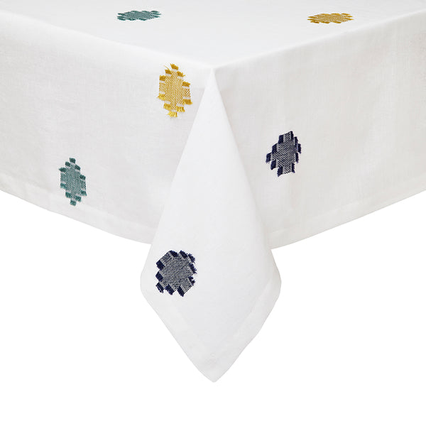 white tablecloth with blue mustard woven pattern