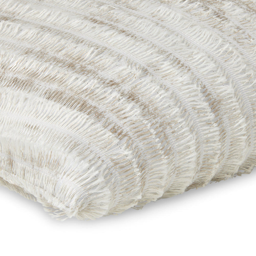 Neutral decorative pillow with fringe