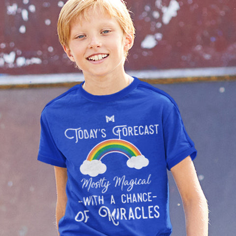 "Young Boy Wearing Royal Blue T-Shirt That Says ""Today's Forecast - Mostly Magical With A Chance Of Miracles"""