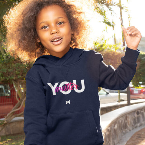 "Happy Toddler Girl Wearing Navy Blue ""You Matter"" Hoodie Sweatshirt While Smiling"