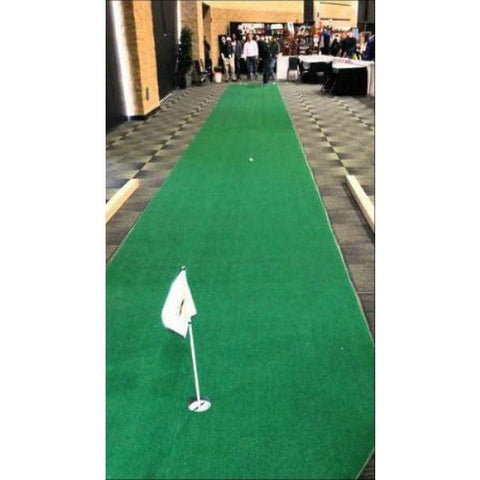 big moss long putt indoor putting green in showroom back flag view