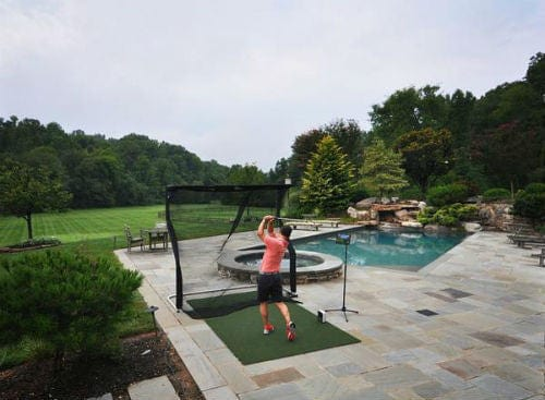 overhead net return home series golf net and pro turf mat poolside