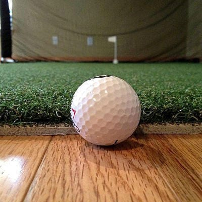 net return pro turf golf hitting mat with ball close up