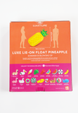 luxe lie on pineapple float