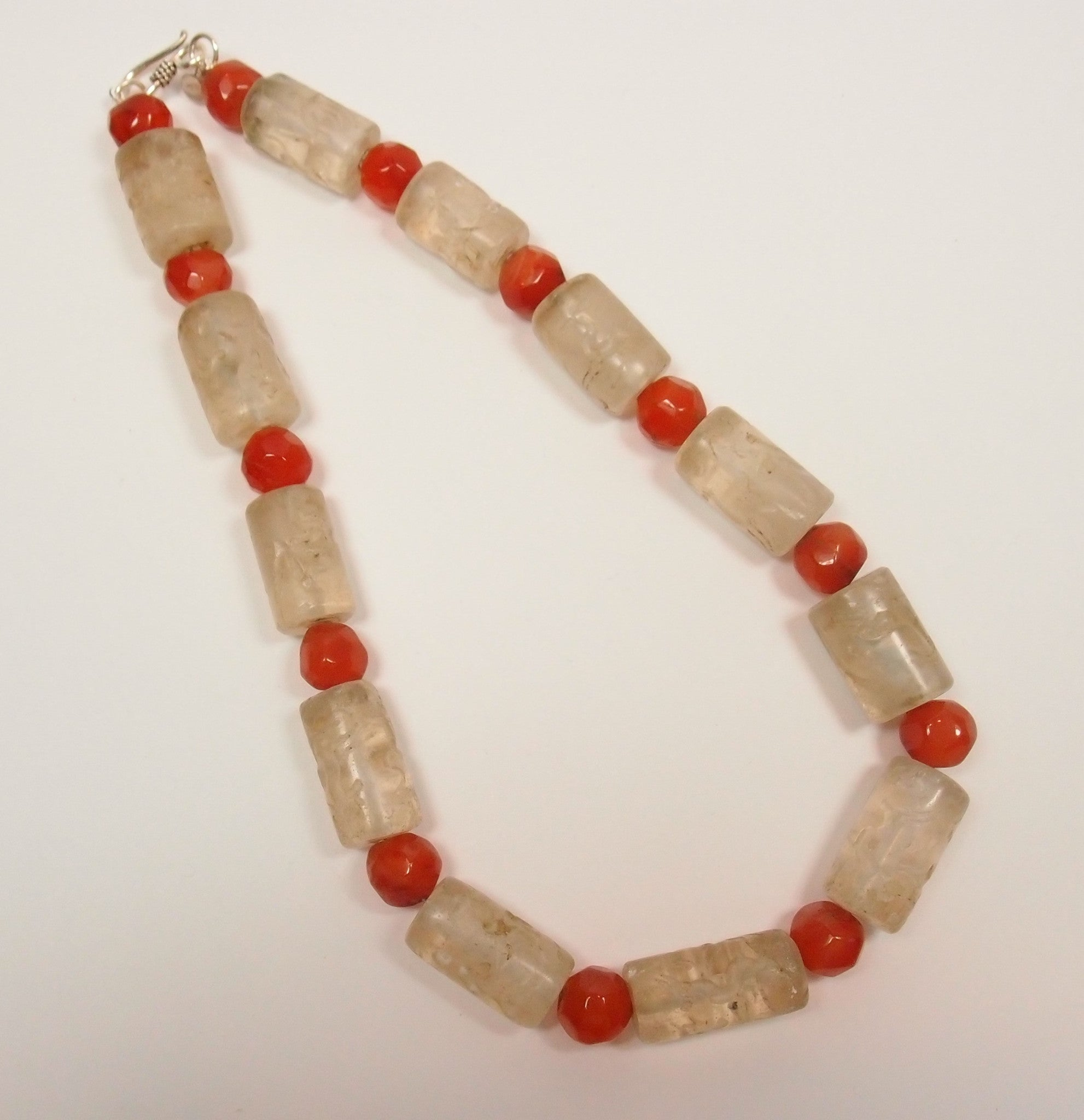 Antique carved rock crystal necklace with hand cut cornelian