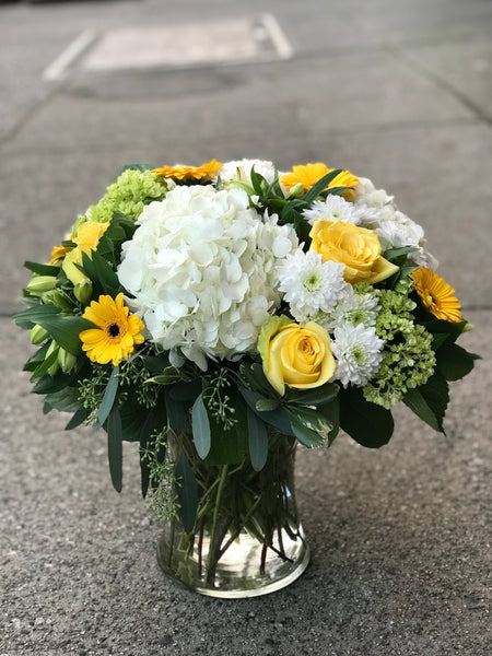 Bright yellows and greens vase arrangement