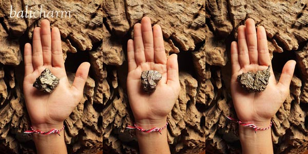 Composite image of hands with Nantan meteorite from Guangxi, China