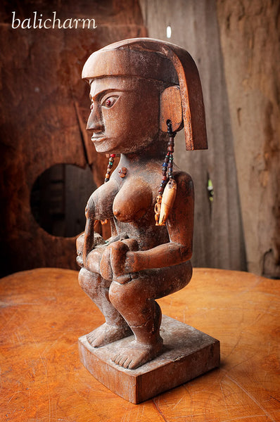 Antique Batak woodcarving of mother and baby with amulets carved from ancient mammoth tusk