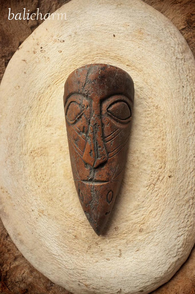 Inuit shamanic mask amulet carved from ancient mammoth ivory