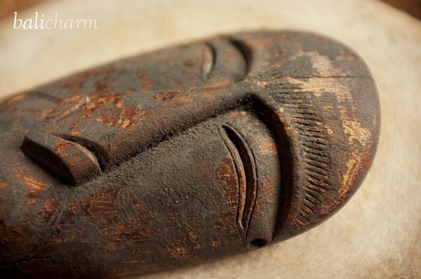 Inuit shamanic mask amulet carved from ancient mammoth tusk