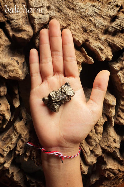 Nantan meteorite from Guangxi, China, held in human hand
