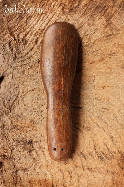 Traditional ethnic Inuit ladle carved from ancient mammoth ivory